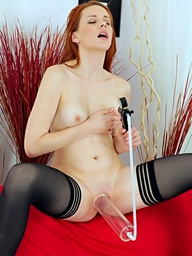 Stunning redhead inserts a keister plug come into..